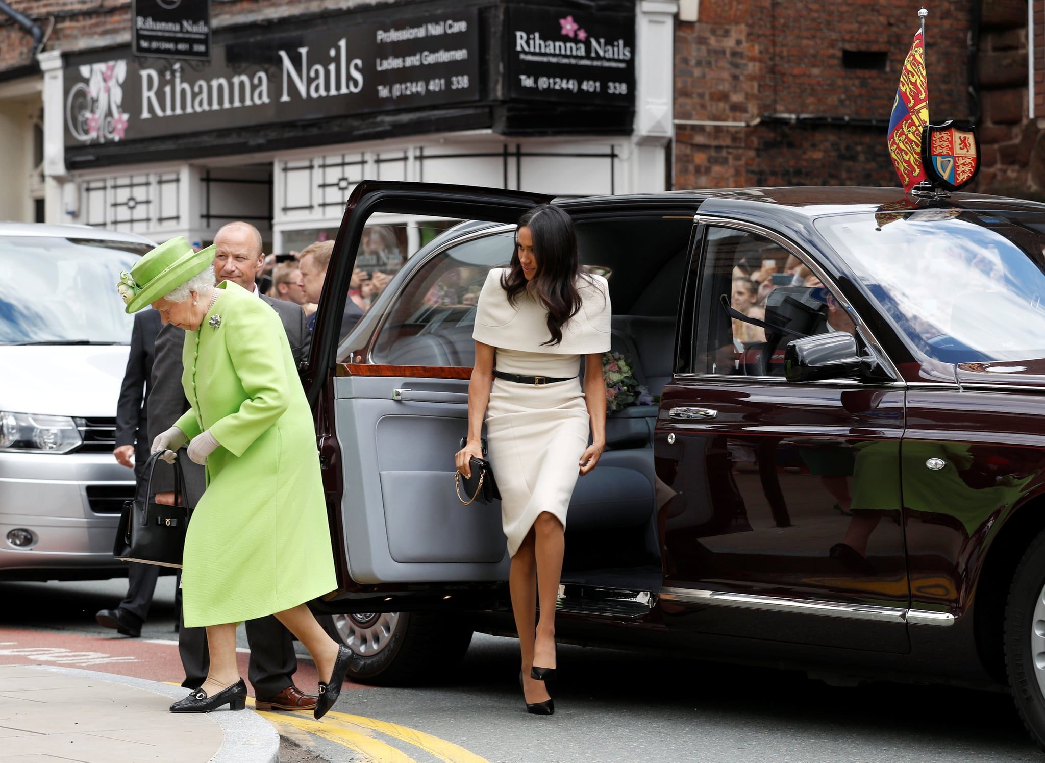 CHESTER, ENGLAND - JUNE 14:  Queen Elizabeth II and Meghan, Duchess of Sussex arrive from their car for their visit to the Storyhouse on June 14, 2018 in Chester, England. Meghan Markle married Prince Harry last month to become The Duchess of Sussex and this is her first engagement with the Queen. During the visit the pair will open a road bridge in Widnes and visit The Storyhouse and Town Hall in Chester.  (Photo by Phil Noble - WPA Pool/Getty Images)