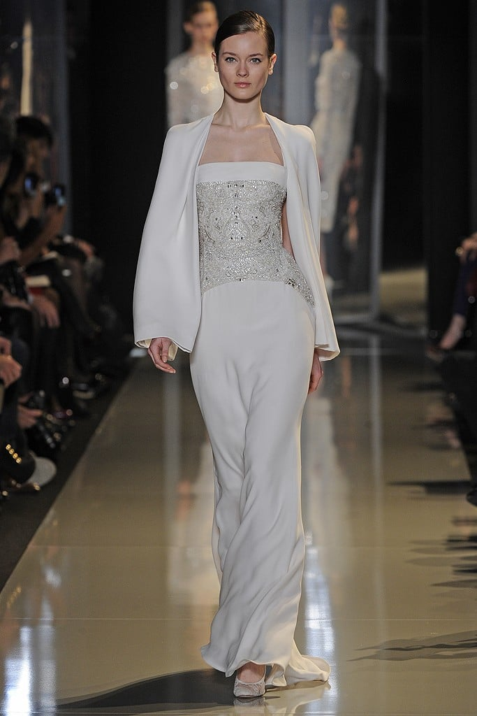 If Gwyneth Paltrow wanted to go the standout white caped gown route á la last year's Oscars look, she should stick with this Elie Saab column dress-and-cape set.