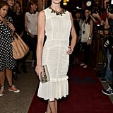 Emily Blunt paired her dress with a necklace and clutch.