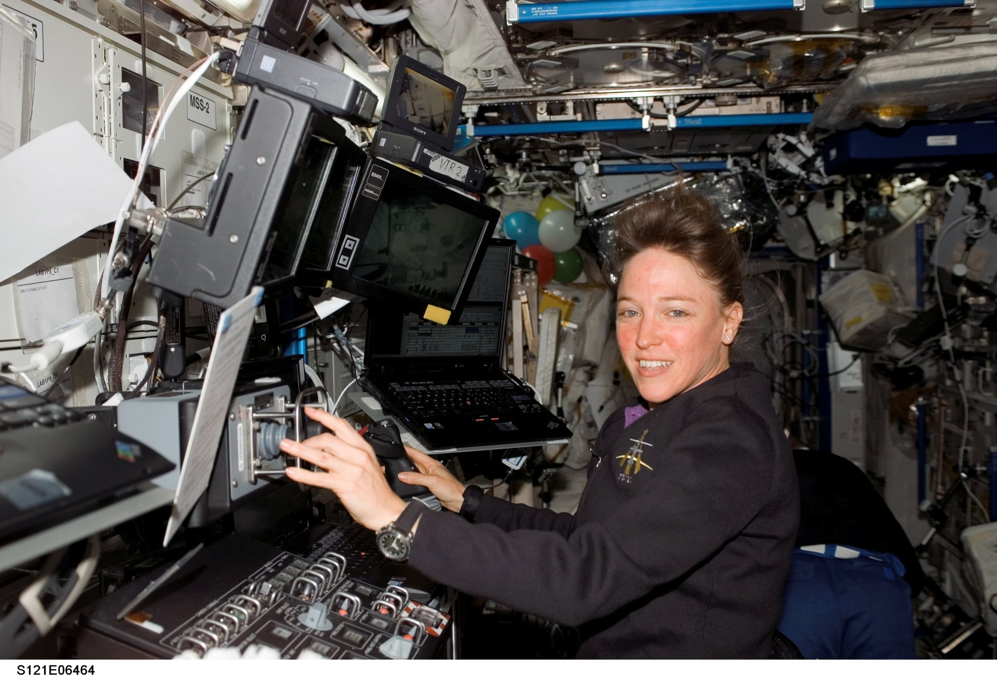 IN SPACE - JULY 13:  Mission specialist Lisa M. Nowak works at the Mobile Service System (MSS) and Canadarm2 controls in the Destiny laboratory of the International Space Station July 13, 2006. Nowak is a crew member aboard the Space Shuttle Discovery, which has been docked to the station since last week.  (Photo by NASA via Getty Images)