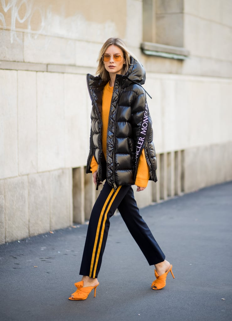Toughen up a feminine silhouette with track pants and a puffy coat or vest.
