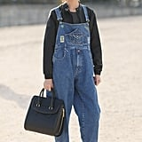 Overalls made fashion-friendly with a leather jacket layered up underneath.