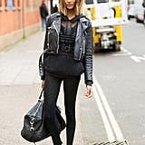 With a sheer top, leather jacket and classic white kicks.