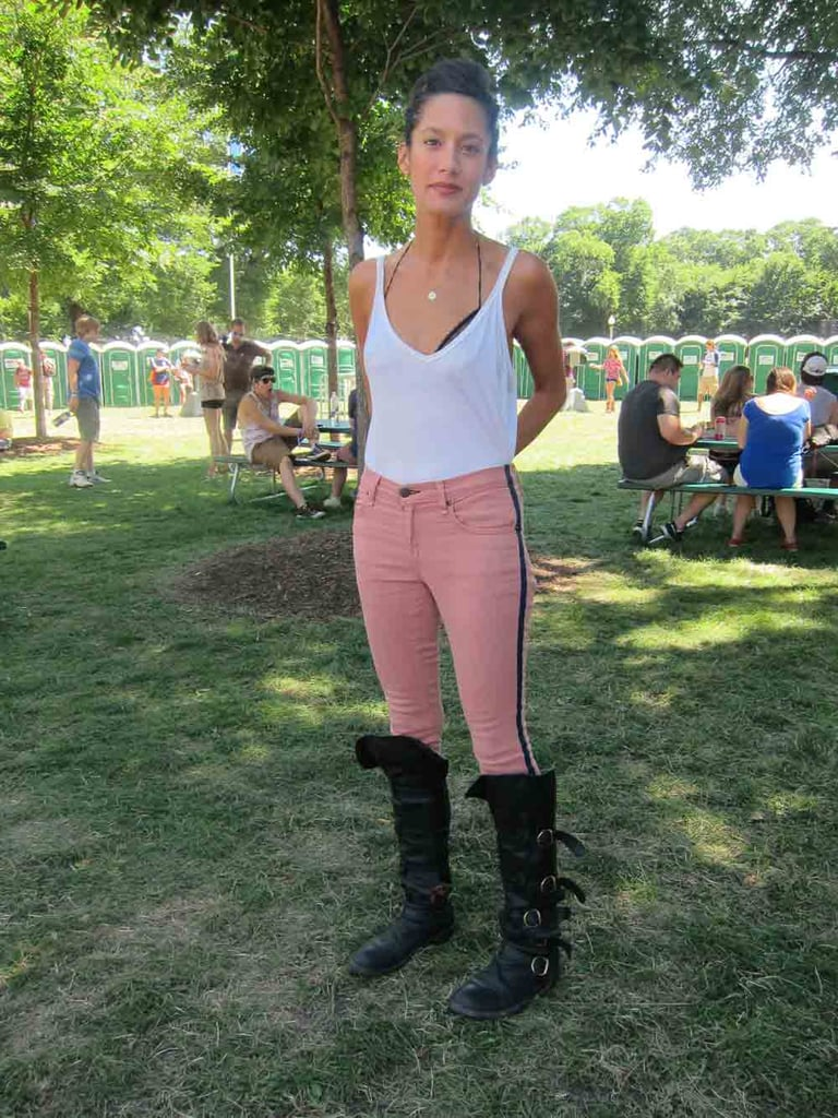 We won't lie: we've seen a lot of bras this weekend. Still, we were surprised with just how chic we thought Beatriz's styling was with her trim white tank over a halter bra. Sure, her pink tuxedo-striped Rag & Bone shoes and Fiorentini & Baker boots didn't hurt.