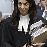 We have to admit, Amal even looks chic in her legal robes. Just don't ask her what she's wearing while she's in court.