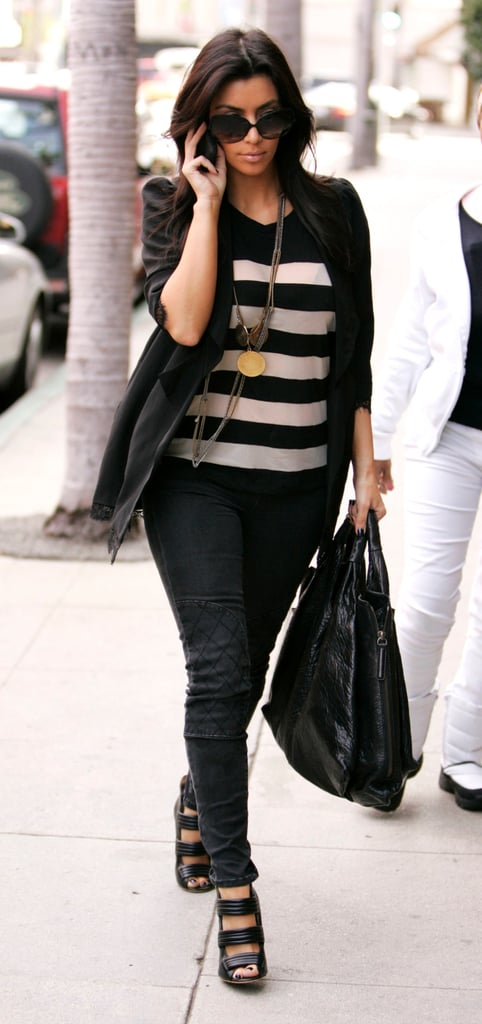 Kim rocked these killer L.A.M.B. pee-toe booties, currently bidding at $200, many times during the first part of 2010. Here she used them to edge up classic stripes in LA, but you can wear them with everything from a little black dress to leather shorts to a flirty printed frock.