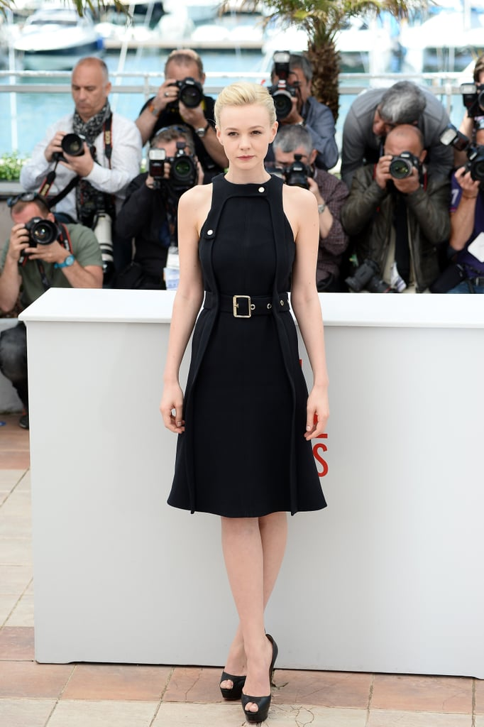 Carey Mulligan took a break from her Great Gatsby duties to promote another film called Inside Llewyn Davis. At the photocall, she wore a sleeveless black Chloé dress — adorned with button details and a wide grommet belt — with black peep-toe platform pumps.