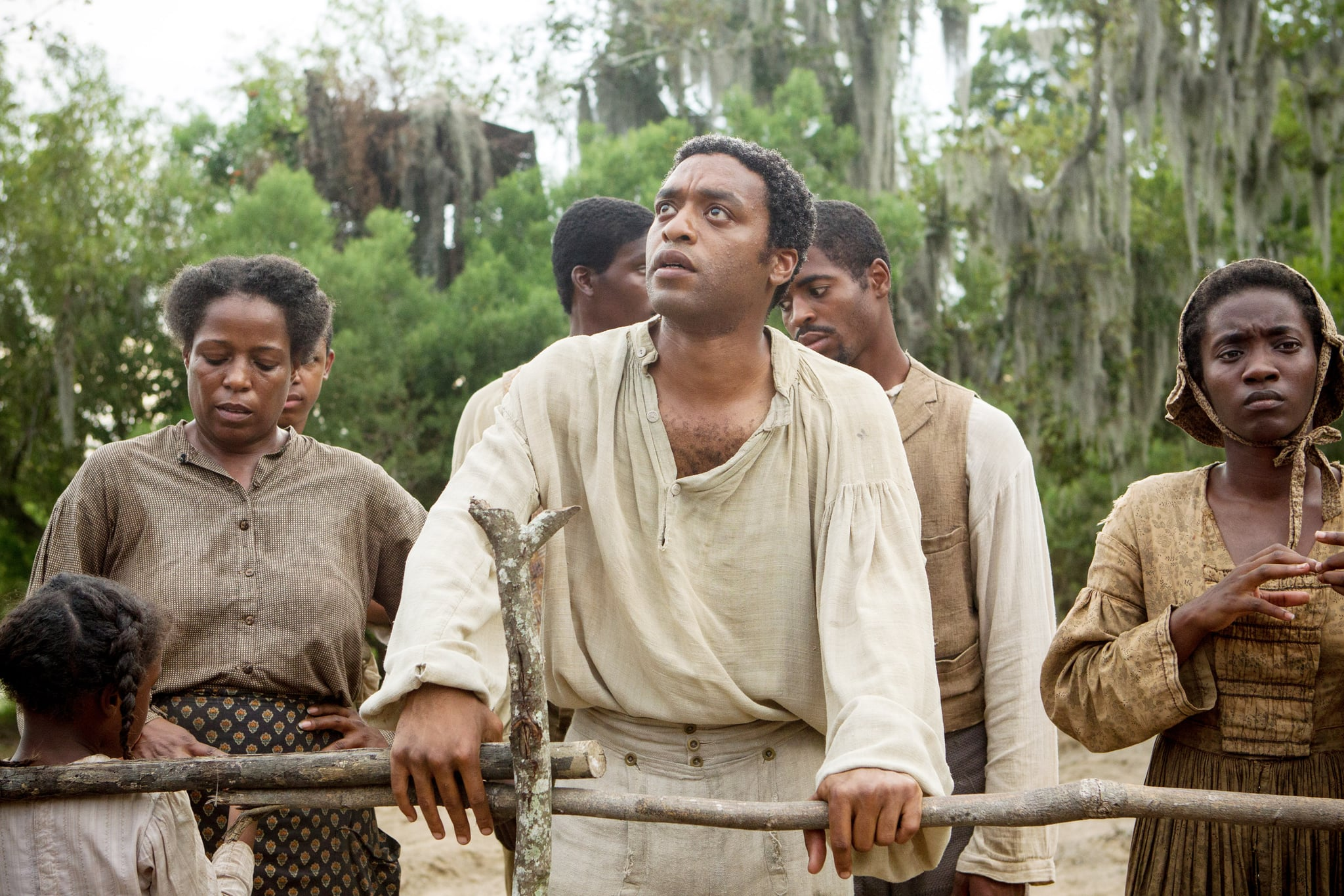 12 YEARS A SLAVE, Chiwetel Ejiofor (center), 2013. ph: Jaap Buitendijk/TM and Copyright Fox Searchlight Pictures. All rights reserved./courtesy Everett Collection