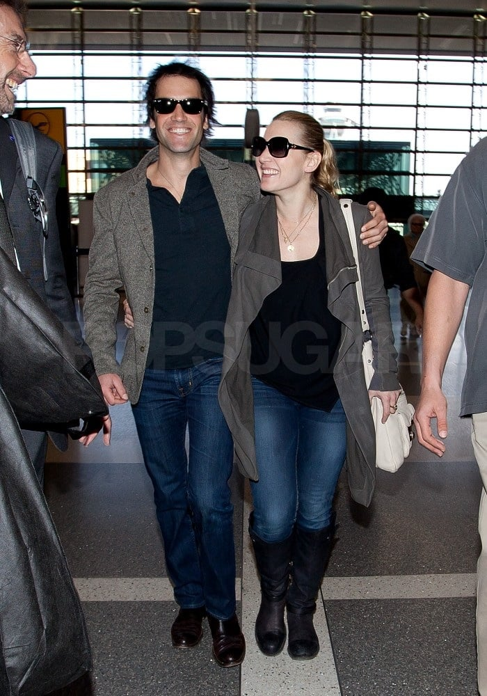 Kate was beaming ear to ear making her way through the terminal.