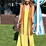 This amazing Forever 21 headpiece set just the right tone for a bohemian queen. We love how this fringe vest layers atop a yellow maxi dress, complete with a leg slit.