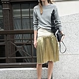 Make Metallics Daytime-Appropriate With a Slinky Knit and Flats