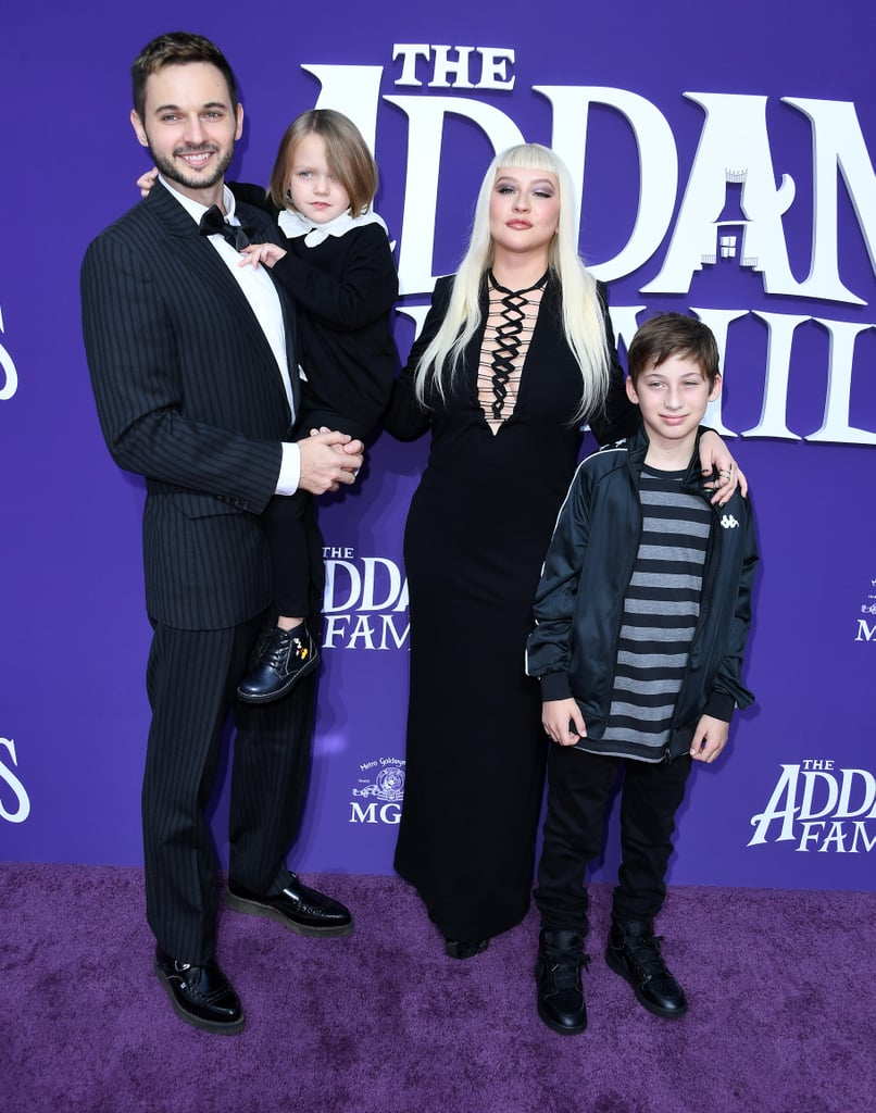 "Christina Aguilera channeled her inner Morticia Addams when she attended the LA premiere of The Addams Family on Sunday. The 38-year-old singer hit the purple carpet in a black dress complete with a black manicure and two snake rings. She also brought her adorable family along for the fun, including fiancé Matthew Rutler, their 5-year-old daughter, Summer, and her 11-year-old son, Max, whom she shares with ex-husband Jordan Bratman.  Christina recently released a new song titled ""Haunted Heart"" for the upcoming animated reboot of The Addams Family. The movie is set to hit theaters on Oct. 11, just in time for Halloween, and includes an all-star cast featuring Oscar Isaac, Charlize Theron, Chloë Grace Moretz, Finn Wolfhard, Nick Kroll, Bette Midler, and Allison Janney.       Related:                                                                                                           Prepare to Be Shocked by How Much Christina Aguilera Has Changed"