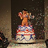 Aja Rock pops out of a cake at the Huffer show during New Zealand Fashion Week 2011.
