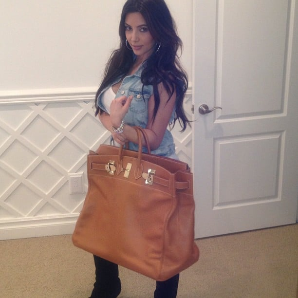 Kim Kardashian tried on a new bag, but it looks like it may be too big? Source: Instagram user kimkardashian