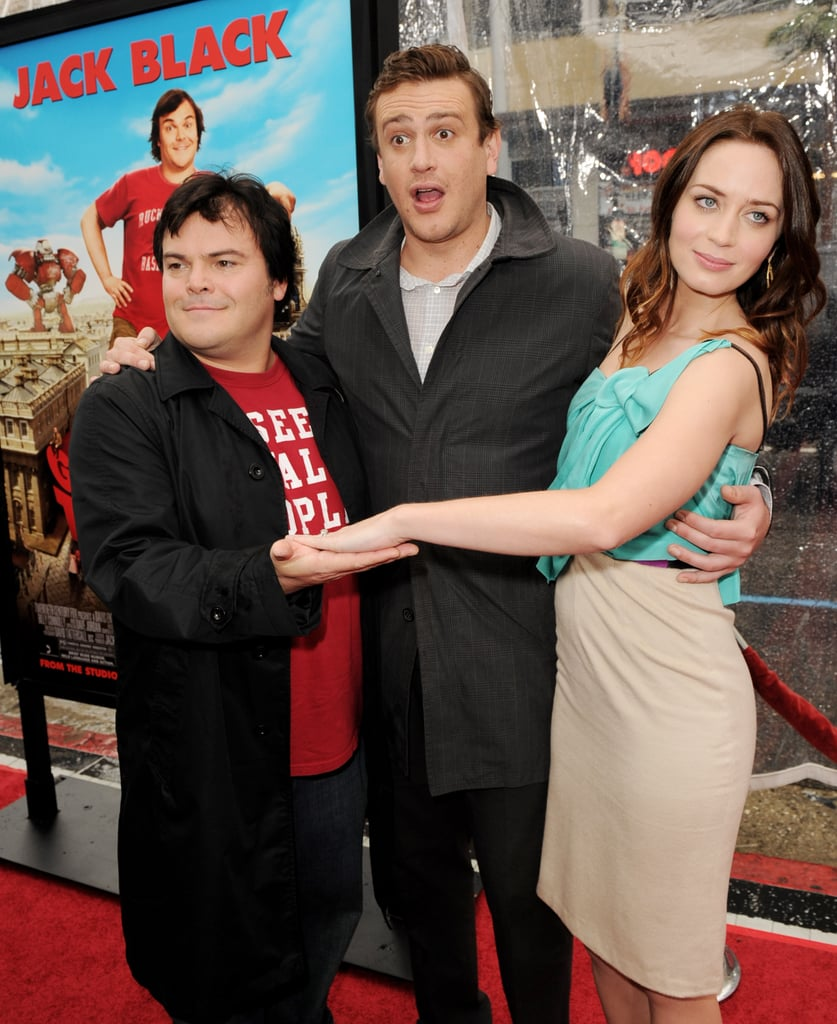 """Emily Blunt joined her comical costars Jack Black and Jason Segel on Saturday morning at the Hollywood premiere of Gulliver's Travels. The family film marks the first time the trio has worked together, but they'll be teaming up again soon in Jason's Muppets Movie. Jason, who wrangled both Emily and Jack into making cameos in his passion project, told us Miss Piggy is a bit of a """"diva"""" on set. Meanwhile, Emily said Ralph was her favourite Muppet to work with on the shoot. The holidays were another much talked-about topic on the red carpet. Emily revealed that she'll spend the season in Boston, her husband John Krasinski's hometown, and the newlyweds were spotted on a flight back East that very evening. Check out today's PopSugar Rush for even more from the red carpet!"""