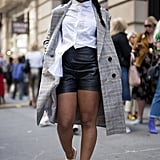 You can pull off the half-tuck with any type of bottom – even shorts. This street-style star added more dimension to her look by folding in part of her top.