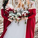 These bridesmaids looked striking in off-the-shoulder red gowns and flower crowns.