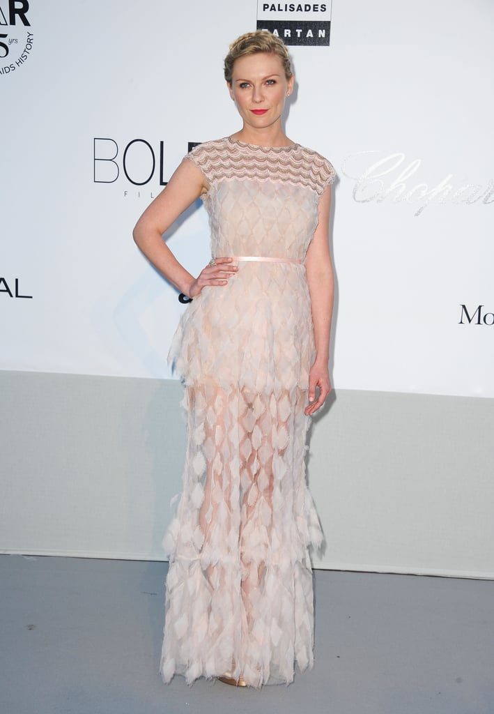 She chose a semisheer Chanel Couture number for the 2011 amfAR Cinema Against AIDS gala.