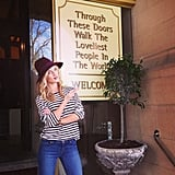 Rosie Huntington-Whiteley wore jeans and a striped top while posing  outside a building.  Source: Instagram user rosiehw