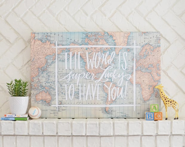 """A vintage map exclaims """"The World Is Super Lucky to Have You!"""" on this canvas ($150-$200), available in two sizes."""
