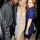 A dashing trio — Chris Rock, Naomi Watts, and Isla Fisher pose, all in Calvin Klein, at the designer's Women in Film party.