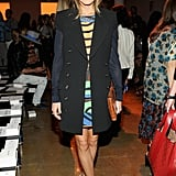 Olivia brightened a sleeveless, double-breasted coat at Peter Som with a colorfully printed dress and neutral heels.