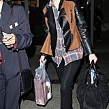 Let's make Carey Mulligan an official member of the cool kids club already. The actress paired a plaid top and black pants with a two-toned, leather-sleeved jacket for an extra dose of warmth. The final movie-star touch? Those nude-framed sunglasses.