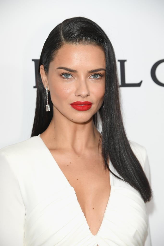 It's no secret that when Adriana Lima steps foot on the runway, her mile-long legs and I-can't-believe-they're-real abs steal the show, but her appearance at the annual Elton John Academy Awards viewing party was no different. The Brazilian supermodel flashed her stunning smile on the white carpet, where we instantly fell into the spell of her eyes. Adriana bared only a bit of her midriff in the figure-hugging white Elisabetta Franchi gown, and the glimpse of her abs proved she doesn't need lingerie to be an angel. The combination of her red lipstick and striking side part helped Adriana shine.