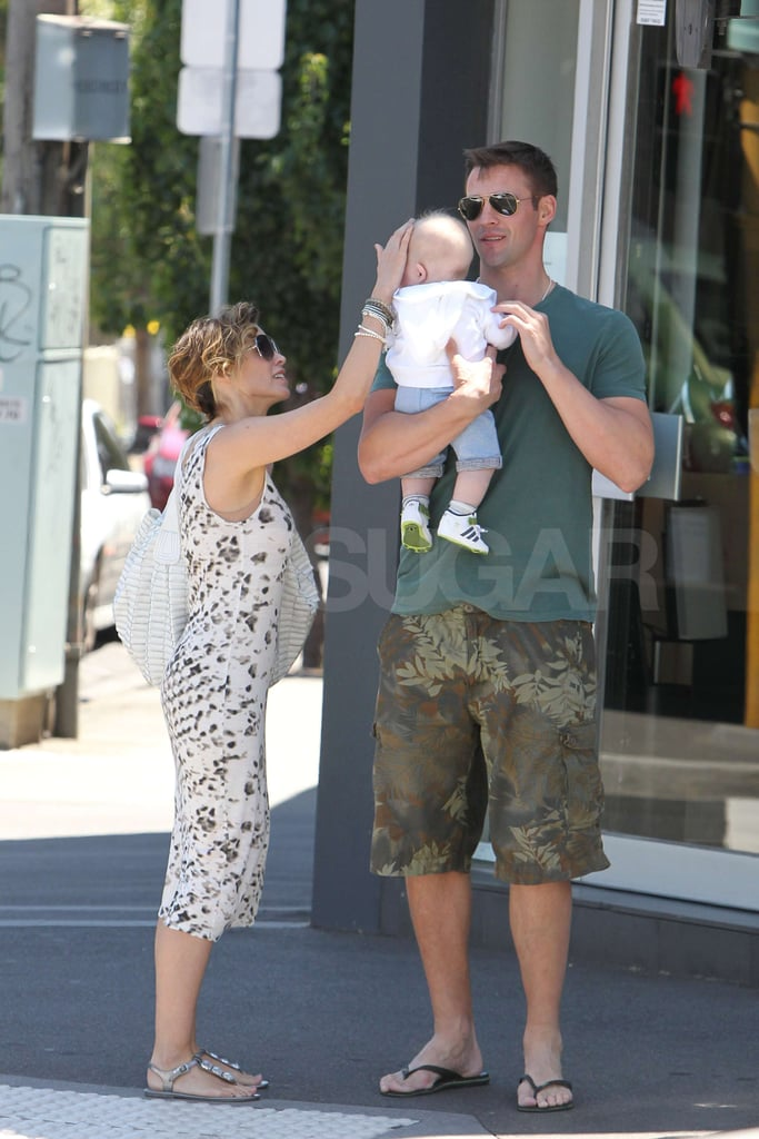 Dannii Minogue stroked her son's face as she shopped with Kris Smith in Melbourne yesterday. The family flew to Australia last month to spend the festive period in the sun. It's not all been leisure time for Dannii though, as she promoted her autobiography in her home town Down Under. Kris has been keeping busy too, and won a pro-am golf tournament. Baby Ethan has been teething, but the trio looked happy as they stopped for lunch on their day out. The family spent New Year's Eve enjoying a BBQ in steamy, sultry Melbourne.