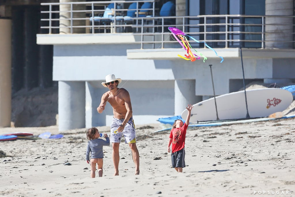 Shirtless Orlando Bloom played with Flynn Bloom on an LA beach.