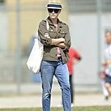 Sideline style: fedora, anorak, boyfriend jeans, and leopard flats.
