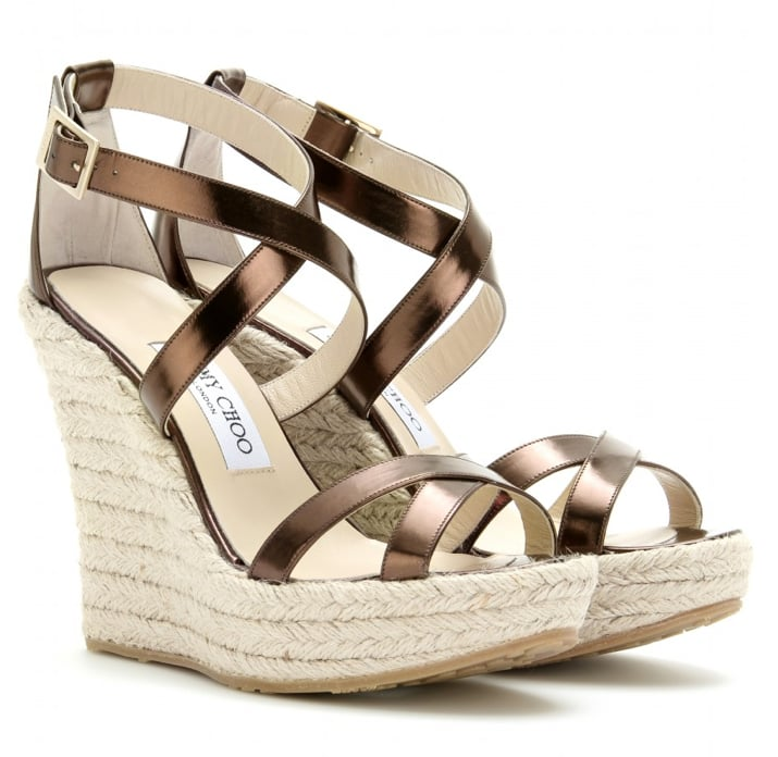 """""""Nothing says Summer like a pair of espadrille sandals. I love the glamorous metallic bronze finish on these Jimmy Choo beauties. Perfect for pairing with breezy LWDs and maxi skirts."""" — Chi Diem Chau, associate editor  Jimmy Choo Porto Leather Espadrilles ($395)"""