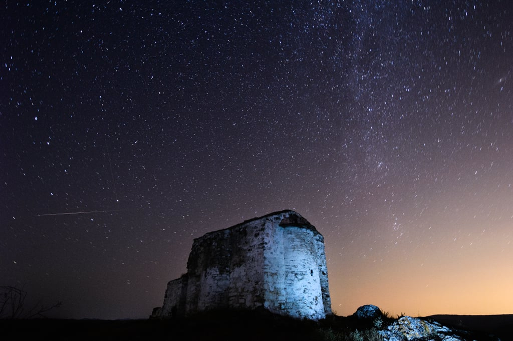 A long exposure photograph over the ruins of St. Ioan, a medieval church near the village of Potsurnentsi, Bulgaria captured a meteor darting across the left side of the sky.