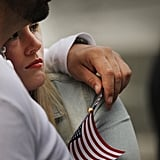 A couple hold each other during the moment of silence at the World Trade Center site.
