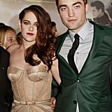 She and costar Robert Pattinson posed together, and we've got to say, the duo inspire fits of cool Fall-hued fancy in their complementary nude and forest green pairing.