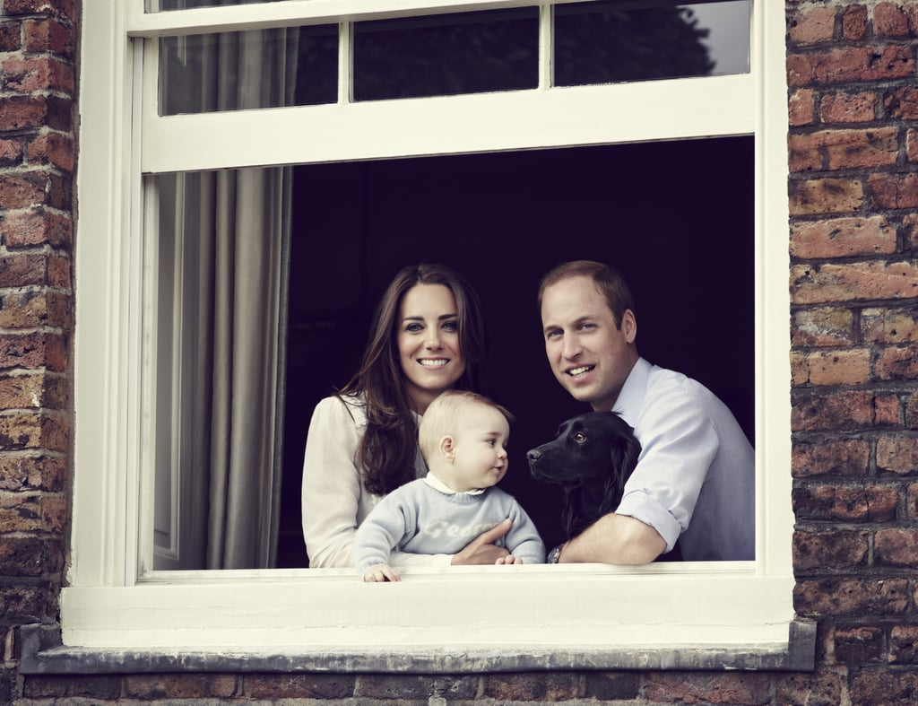 "Kate Middleton and Prince William released a family portrait on Saturday, and it's beyond sweet. The official image shows 8-month-old Prince George in Kate's arms as he locks eyes with their dog, Lupo. Meanwhile, Kate and William beam as they casually nestle near a windowsill in their Kensington Palace apartment. If you look closely, you'll see ""George"" written on the little prince's baby blue sweater. The image, taken by photographer Jason Bell in mid-March, marks the first time the family has released an official portrait since George's christening last October. For that milestone, Jason took five official portraits. Prince George and Lupo are clearly building a sweet bond as the young royal grows. The cocker spaniel was included in the family's first official photo, taken by Kate's father, Michael Middleton. When that sweet snap was taken, Lupo looked away with his tongue hanging out, as George rested in his mum's arms with his eyes closed. The excitement over growing George's latest moment with his parents started when CNN's Max Foster tweeted the image on Saturday, mere hours after Kate and William joined Prince Harry at a wedding. The photogenic family members are destined to grab even more headlines when they tour Australia and New Zealand for three weeks in April. It will be George's first official trip abroad!"