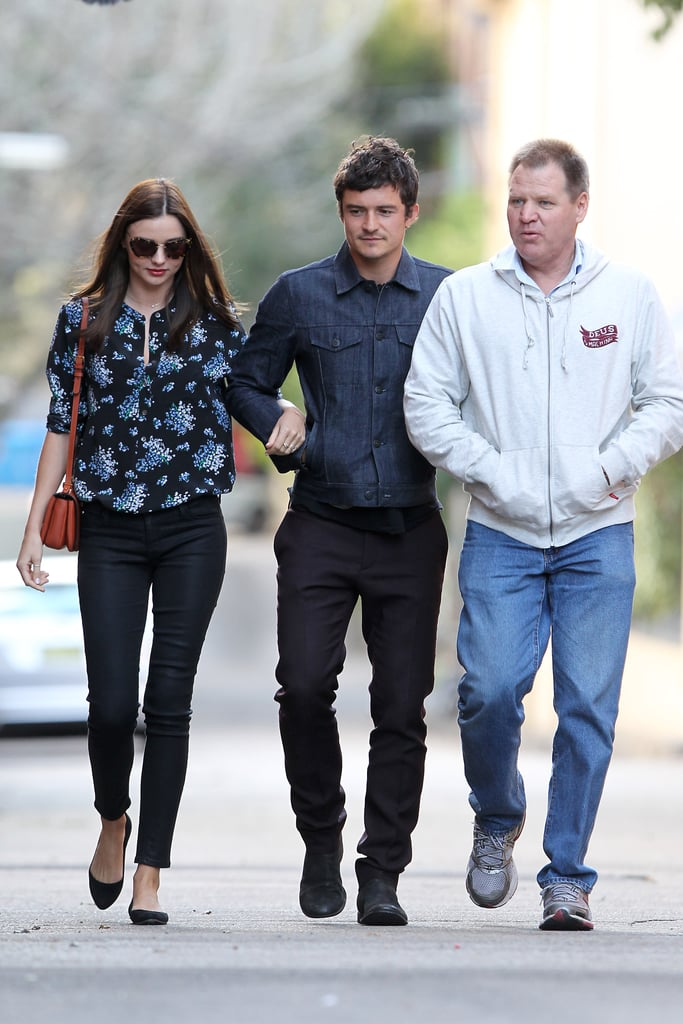 Miranda Kerr and Orlando Bloom held hands as they left a lunch service at Chiswick in Sydney today. The celebrity couple were accompanied by Miranda's father, John, who celebrated his birthday backstage at David Jones' Spring/Summer 2012 fashion launch last week. Miranda and Orlando's cute son, Flynn, wasn't with them, but he does feature in an adorable new editorial that appeared in T, the New York Times' style magazine, over the weekend, that Orlando photographed in New Zealand while shooting The Hobbit. Orlando arrived in Sydney yesterday and was spotted spending some quality father-son time with Flynn. The genetically-blessed family also enjoyed a Hamilton Island getaway a few weeks ago.
