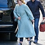 Another trend that Adele mastered was a bright colored Winter coat, which she wore over the weekend with a pair of Converse sneakers.