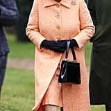 Why the Queen Wears Many Bright Colors