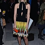 Ali Larter rocked an eclectic black cutout dress featuring a colorful printed skirt, then furthered the fun with a bright orange box clutch at an event in NYC.