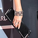 She carried a black Swarovski clutch with crystal pavé borders and wore coordinating  Lorraine Schwartz geometric bangles on each wrist.