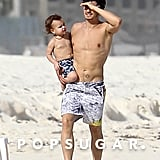 Shirtless Orlando Bloom carried Flynn in Cancun.