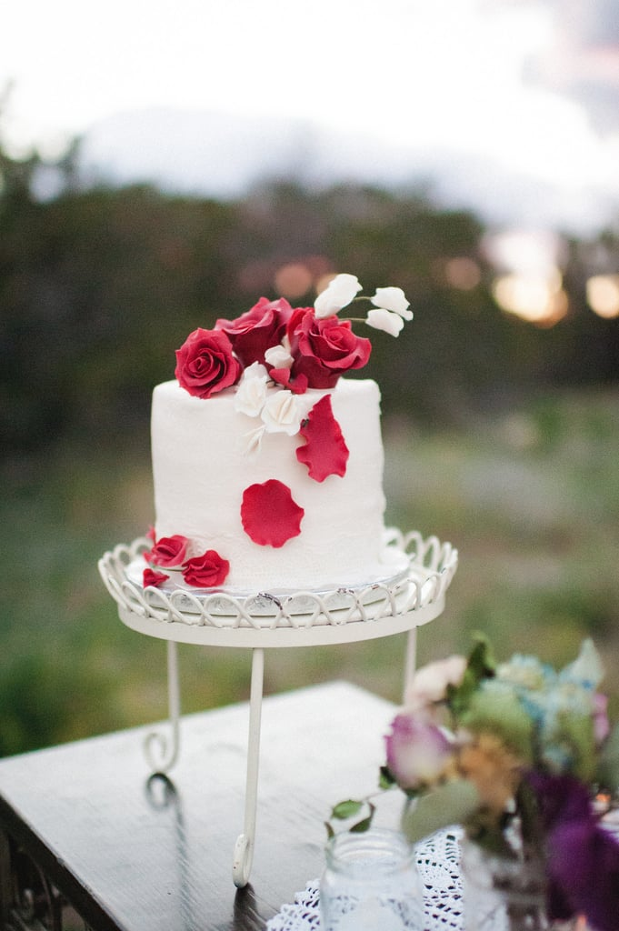 How sweet is this one-tiered cake topped with roses? It's almost too pretty to eat (emphasis on almost) and leaves room to serve other treats like cupcakes and cake pops.