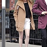 Emma Stone looked cute in high waisted shorts and heels as she and her boyfriend Andrew Garfield took a walk.