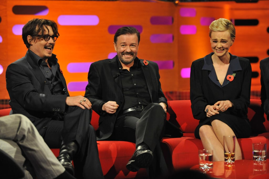 """Johnny Depp and Carey Mulligan both made appearances on The Graham Norton Show in London yesterday. Ricky Gervais was also a guest for the star-studded taping of the popular UK talk show that will air today. Johnny sat down to chat about The Rum Diary, which opened in the US last week, while Carey took a break from filming The Great Gatsby for the interview. Carey opened up about her kissing scenes with Johnny in 2009's Public Enemies and said they were cut from the movie because she looked too uncomfortable. She also shared that her nervousness has continued on set with Leonardo DiCaprio, whom she stars opposite in Gatsby, saying, """"I grew up watching everything he's ever done and it's difficult as I have to hide my inner fan when I am around him, it's terrible."""" Carey added that Leo """"claims not to be able to dance when we do a dancing scene and I have to hide the fact that I know he can because I saw him dance in Titanic."""""""