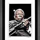 If your father is a big fan of the blues, he'll be excited to see this limited edition BB King print on his wall.  BB King by Jerome Brunet Framed Print ($550 and up)