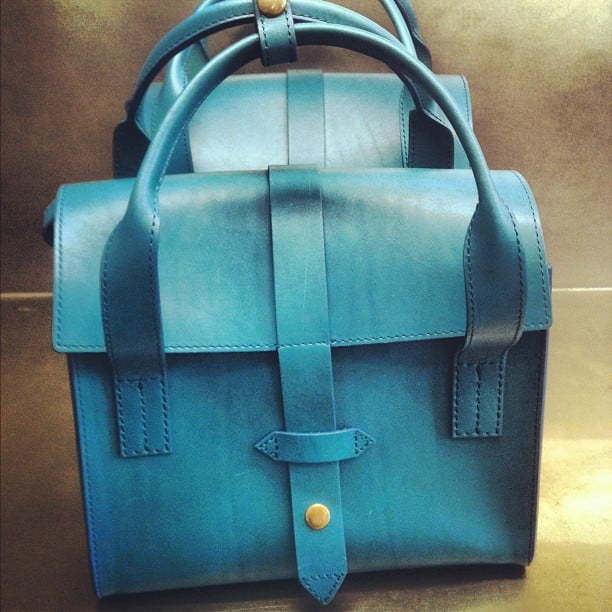 Baby-blue satchels under $200 and for a charitable cause at IIIBecca's Joy Gryson bag launch.