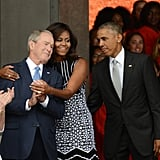 Sharing embraces at the National Museum of African American History and Culture's dedication in 2016