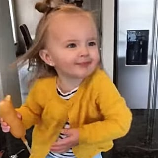 Toddler Girl Holding Corn Dog Dances to Beyonce
