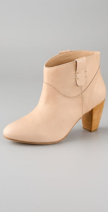 This Rebecca Minkoff Doll Pull Tab Bootie ($350) has a cool neutral hue, and we love the comfy stacked heel.